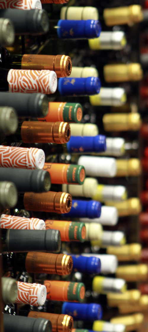 Keith Johnson | The Salt Lake Tribune   Colorful bottles of Spanish wines decorate the shelves of the State Wine Store on Harris Avenue in Salt Lake City, Oct. 9, 2013. French wine scholar Sheral Schowe offers a 90-minute class at the wine store to help beginners and novices better navigate the store's large selection, find great deals and interpret wine labels from around the world.