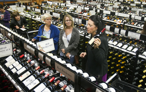 Keith Johnson | The Salt Lake Tribune   Barbara Gelegotis, left, Jean Stephenson and Maria Valentine listen to French wine scholar Sheral Schowe, right, during Schowe's 90-minute class at the State Wine Store on Harris Ave. in Salt Lake City, Oct. 9, 2013.  Schowe offers the class for beginners and novices to help them better navigate the wine store, find great deals and interpret wine labels from around the world.