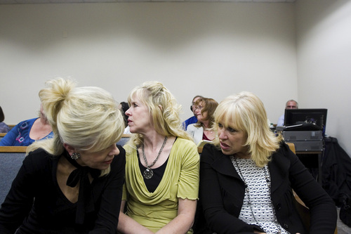 Spenser Heaps  |  Pool Family members of Michele MacNeill listen during the trial of Martin MacNeill at 4th District Court in Provo on Wednesday, Oct. 23, 2013. MacNeill, a Pleasant Grove physician, is charged with murder for allegedly killing his wife Michele MacNeill in 2007.