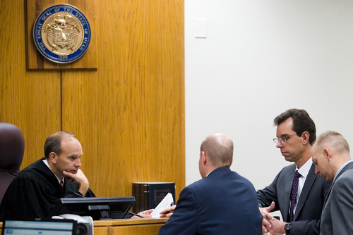 Spenser Heaps  |  Pool  Judge Derek Pullan, left, speaks with Utah County Prosecutors Chad Grunander, second-from-left, Sam Pead, right, and defense attorney Randy Spencer, second-from-right during the trial of Martin MacNeill at 4th District Court in Provo on Wednesday, Oct. 23, 2013. MacNeill, a Pleasant Grove physician, is charged with murder for allegedly killing his wife Michele MacNeill in 2007.