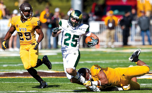 Cowboys linebacker Jordan Stanton (1) tackles Colorado State wide receiver Joe Hansley (25) during the first half of an NCAA college football game against Colorado State on Saturday, Oct. 19, 2013, in Laramie, Wyo. (AP Photo/Laramie Boomerang, Jeremy Martin)
