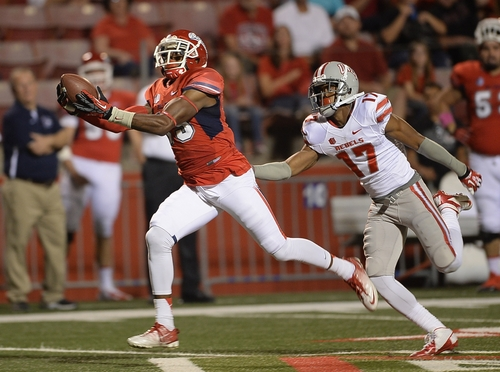 Davante Adams catches a touchdown pass from Derek Carr on the first play of the game against UNLV's Kenneth Penny defending on Oct. 19, 2013. (AP Photo/The Fresno Bee, Mark Crosse)