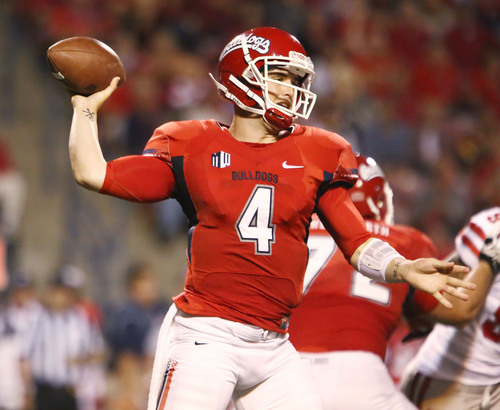 Fresno State quarterback Derek Carr (4)(17) tosses a pass against UNLV during the first half of an NCAA college football game Saturday, Oct. 19, 2013, in Fresno, Calif. (AP Photo/Gary Kazanjian)