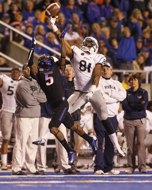 Boise State cornerback Donte Deayon (5) and Nevada wide receiver Aaron Bradley (81) leap for a pass intended for Richardson during the second half of an NCAA college football game in Boise, Idaho, Saturday, Oct. 19, 2013. The pass was incomplete. Boise State won 34-17. (AP Photo/Otto Kitsinger)