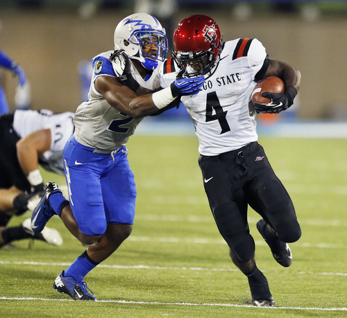 Air Force defensive back Christian Spears tackles San Diego State running back Adam Muema during the first quarter of an NCAA college football game at the Air Force Academy, Colo. Thursday, Oct. 10, 2013. (AP Photo/Brennan Linsley)