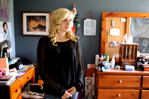 """Sarah Ball, a victim of cyber bullying during her high school years, poses for a portrait at her home on Wednesday, Oct. 23, 2013, in Spring Hill, Fla. Ball, now a student at a nearby community college, maintains a Facebook site called """"Hernando Unbreakable"""", an anti-bullying page and mentors local kids identified by the schools as victims of cyberbullying. (AP Photo/Brian Blanco)"""