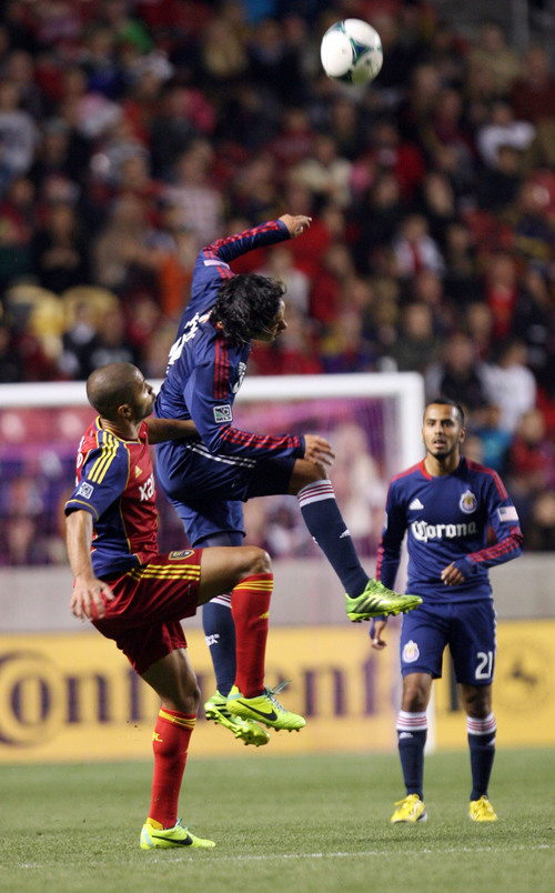 Steve Griffin  |  The Salt Lake Tribune   Chivas USA defender Mario de Luna leaps above RSL forward Alvaro Saborio as he heads the ball during second half action in the Real Salt Lake versus Chivas USA soccer match at Rio TInto Stadium in Sandy, Utah Wednesday, October 23, 2013.
