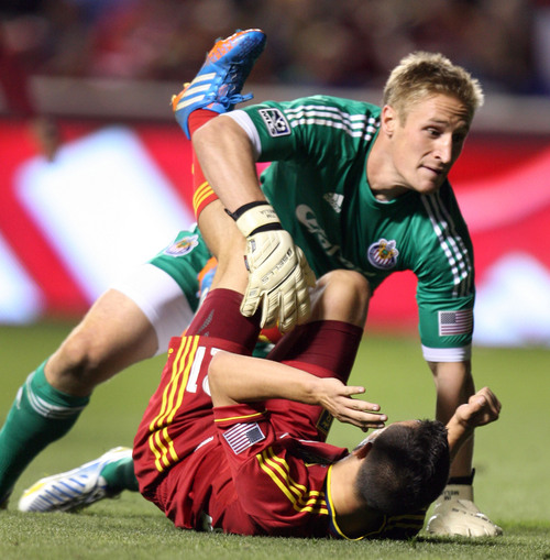 Steve Griffin  |  The Salt Lake Tribune   Chivas USA goal keeper Tim Melia, back, and RSL's midfielder Luis Gil crash into each other during second half action in the Real Salt Lake versus Chivas USA soccer match at Rio TInto Stadium in Sandy, Utah Wednesday, October 23, 2013.