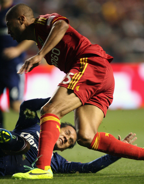 Steve Griffin  |  The Salt Lake Tribune   Chivas USA defender Mario de Luna slides and knocks the ball away from RSL forward Alvaro Saboria during first half action in the Real Salt Lake versus Chivas USA soccer match at Rio Tinto Stadium in Sandy, Utah Wednesday, October 23, 2013.