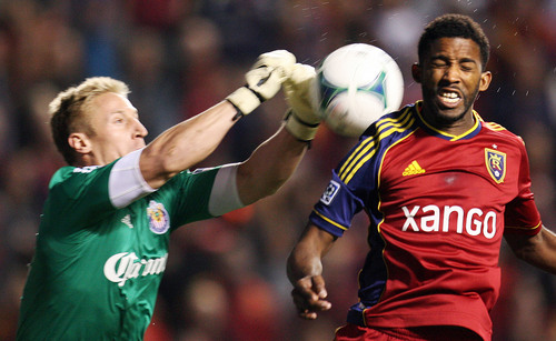 Steve Griffin  |  The Salt Lake Tribune   Chivas USA goal keeper Tim Melia punches the ball away from RSL forward Yordany Alvarez during first half action in the Real Salt Lake versus Chivas USA soccer match at Rio TInto Stadium in Sandy, Utah Wednesday, October 23, 2013.