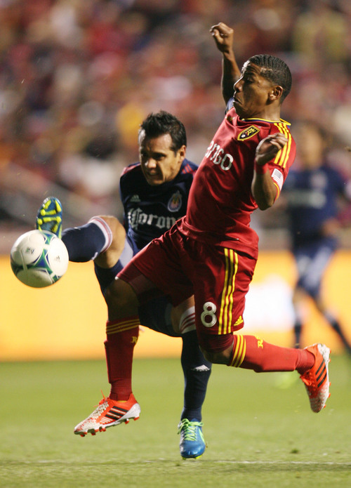 Steve Griffin  |  The Salt Lake Tribune   Chivas USA defender Mario de Luna, left, tries to kick the ball away from RSL forward Joao Plata during first half action in the Real Salt Lake versus Chivas USA soccer match at Rio TInto Stadium in Sandy, Utah Wednesday, October 23, 2013.