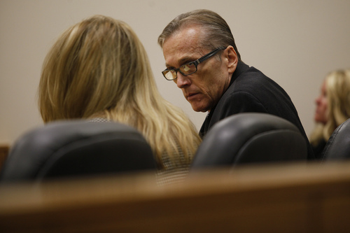 Mark Johnston  |  Pool  Pleasant Grove physician Martin MacNeill, right, charged with murder for allegedly killing his wife Michele MacNeill in 2007, speaks with his attorney Susanne Gustin in Judge Derek Pullan's 4th District Court in Provo Tuesday, Oct. 22, 2013.