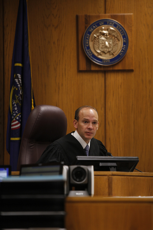 Mark Johnston  |  Pool  Judge Derek Pullan speaks to attorneys during the trial of Martin MacNeill at the 4th District Court in Provo Tuesday, Oct. 22, 2013. MacNeill is charged with murder for allegedly killing his wife Michele MacNeill in 2007.