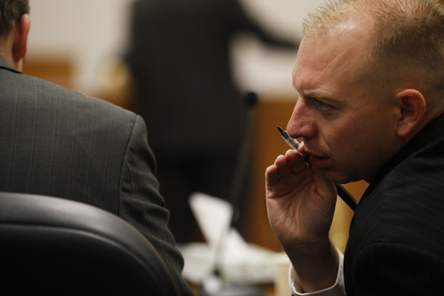 Mark Johnston  |  Pool  Utah County Prosecutor Sam Pead, right, speaks with a fellow attorney during the trial of Martin MacNeill at the 4th District Court in Provo Tuesday, Oct. 22, 2013. MacNeill is charged with murder for allegedly killing his wife Michele MacNeill in 2007.