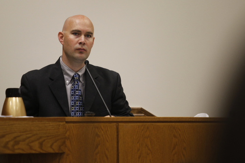 Mark Johnston  |  Pool  Sgt. Joshua Motsinger, with the Pleasant Grove Police Department, testifies during the trial of Martin MacNeill at the 4th District Court in Provo Tuesday, Oct. 22, 2013. Motsinger responded to the MacNeill home the day MacNeill's wife, Michele MacNeill, died. Martin MacNeill is charged with murder for allegedly killing his wife.