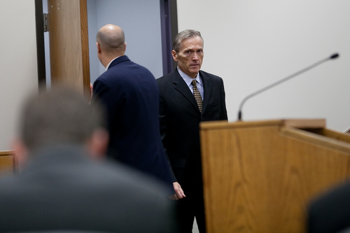 Mark Johnston  |  Pool  Pleasant Grove physician Martin MacNeill, charged with murder for allegedly killing his wife Michele MacNeill in 2007, appears in Judge Derek Pullan's 4th District Court in Provo Tuesday, Oct. 22, 2013.