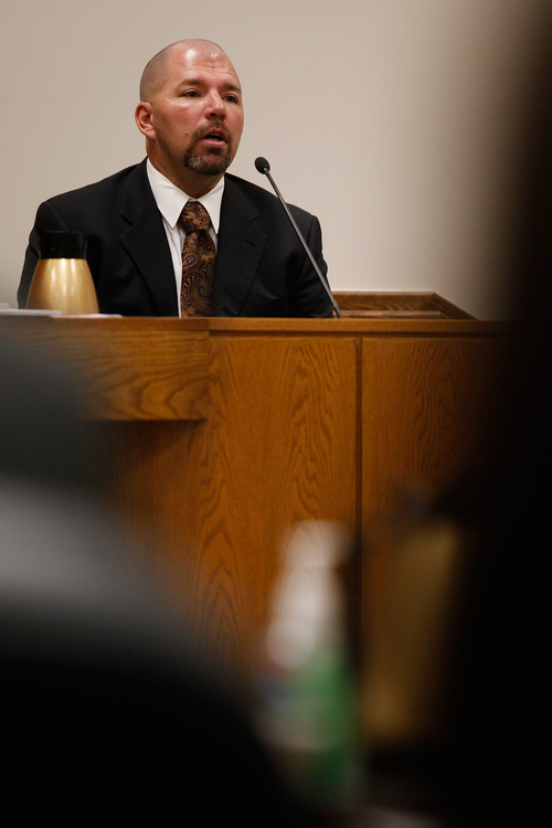 Mark Johnston  |  Pool  Marc Wright, a former detective with the Pleasant Grove Police Department, testifies during the trial of Martin MacNeill at the 4th District Court in Provo Tuesday, Oct. 22, 2013. Wright responded to the MacNeill home the day MacNeill's wife, Michele MacNeill, died. Martin MacNeill is charged with murder for allegedly killing his wife.