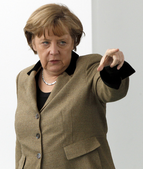 "Michael Sohn  |  AP German Chancellor Angela Merkel says the surveillance of her cell phone by U.S. Intelligence services, if confirmed, is ""totally unacceptable."""