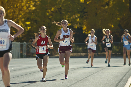 Chris Detrick  |  The Salt Lake Tribune Bountiful's Cailey Lloyd and Mountain View's Katherine Luque compete during the 4A state cross country race at Sugar House Park Wednesday October 23, 2013. Ogden senior Sarah Feeny won with a time of 17:25.0.