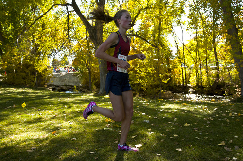 Chris Detrick  |  The Salt Lake Tribune Herriman junior Lucy Biles competes during the 5A state cross country race at Sugar House Park Wednesday October 23, 2013. Herriman junior Lucy Biles won with a time of 17:41.9.