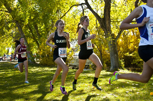 Chris Detrick  |  The Salt Lake Tribune Davis' Aubrey Argyle and Taylor Cox compete during the 5A state cross country race at Sugar House Park Wednesday October 23, 2013. The Davis Darts became the second program in a day to become the fastest team in the stateís history of girlsí high school cross-country with a combined time of 92 minutes, 27 seconds, shattering the Bingham mark of 93:50 set in 1999 and Park Cityís mark of 93:36.