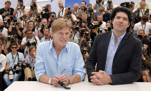 Actor Robert Redford, left, and director J.C. Chandor pose during a photo call for the film All is Lost at the 66th international film festival, in Cannes, southern France, Wednesday, May 22, 2013. (AP Photo/Francois Mori)