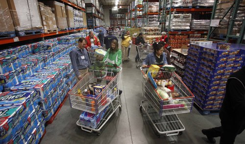 FILE - This Dec. 7, 2011, file photo, shows customers shopping at a Costco, in Portland, Ore. The Commerce Department will release its wholesale trade inventories report, Friday, Oct. 25, 2013. (AP Photo/Rick Bowmer, File)