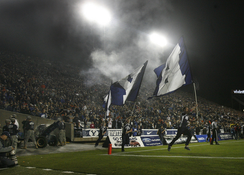 Scott Sommerdorf   |  The Salt Lake Tribune BYU flag runners get a work out after another BYU TD in the first half. BYU held a 24-3 lead over Boise State, Friday, October 25, 2013