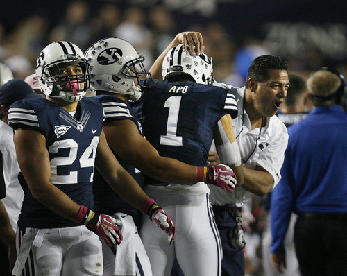 Scott Sommerdorf   |  The Salt Lake Tribune BYU offensive coordinator Robert Anai congratulates WR Ross Apo after Apo's 37 yard TD catch that made the score 17-3, BYU. BYU held a 24-3 lead over Boise State, Friday, October 25, 2013
