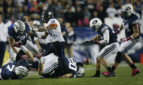 Scott Sommerdorf   |  The Salt Lake Tribune BYU's defense pounces on a fumble by Boise State Broncos wide receiver Shane Williams-Rhodes (11) that led to Cody Hoffman's 4 yard TD catch that gave BYU a 24-3 lead over Boise State at the half, Friday, October 25, 2013