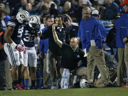 Scott Sommerdorf   |  The Salt Lake Tribune There was a scare during first half lay when BYU DB Justin Sorenson went down. BYU team mates BYU held a 24-3 lead over Boise State, Friday, October 25, 2013