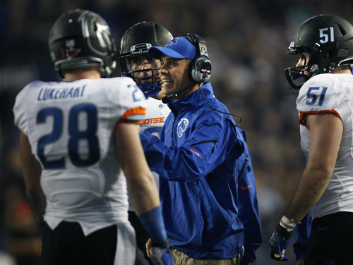 Scott Sommerdorf   |  The Salt Lake Tribune Boise State Broncos head coach Chris Petersen talks with his team during a time out in the first half. BYU held a 24-3 lead over Boise State, Friday, October 25, 2013