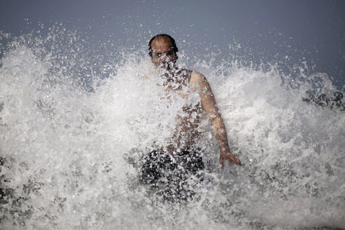 A Yemeni man swims in a beach to cool off in the port city of Hudaida, southwest of Sanaa, Yemen, Friday, Oct. 25, 2013. The temperature in Hudaida reached a high of 93 degrees Fahrenheit (34 degrees Celsius) on Friday.  (AP Photo/Hani Mohammed)