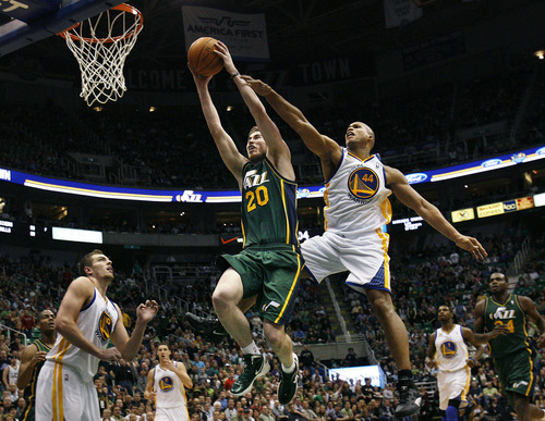 Scott Sommerdorf  |  The Salt Lake Tribune              Jazz forward Gordon Hayward made this spectacular driving dunk past the Warrior's Richard jefferson during fourth quarter play to energize the team. The Utah Jazz defeated the Golden State Warriors 99-92 in OT at Energy Solutions Arena, Saturday, March 17, 2012.