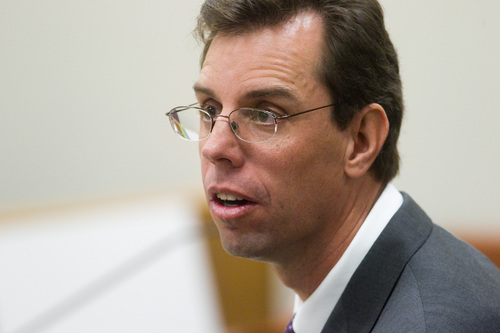 Spenser Heaps  |  Pool  Defense attorney Randy Spencer talks to prosecutors during the trial of Martin MacNeill at 4th District Court in Provo on Wednesday, Oct. 23, 2013. MacNeill, a Pleasant Grove physician, is charged with murder for allegedly killing his wife Michele MacNeill in 2007.
