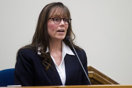 Spenser Heaps  |  Pool  Melissa Frost, a former work associate of Martin MacNeill, testifies during MacNeill's trial at 4th District Court in Provo on Wednesday, Oct. 23, 2013. MacNeill, a Pleasant Grove physician, is charged with murder for allegedly killing his wife Michele MacNeill in 2007.