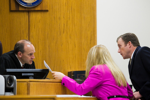 Spenser Heaps  |  Pool  Judge Derek Pullan, left, speaks to defense attorney Susanne Gustin, center, and Utah County prosecutor Jared Perkins, right, during the trial of Martin MacNeill at 4th District Court in Provo on Wednesday, Oct. 23, 2013. MacNeill, a Pleasant Grove physician, is charged with murder for allegedly killing his wife Michele MacNeill in 2007.