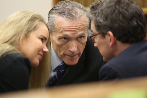 Francisco Kjolseth  |  The Salt Lake Tribune Pleasant Grove physician Martin MacNeill, center, charged with murder for allegedly killing his wife, Michele MacNeill in 2007 so he could continue and extramarital affair, speaks with defense attorney's Susanne Gustin and Caleb Proulx in Judge Derek Pullan's 4th District Court in Provo on Friday, Oct. 25, 2013.