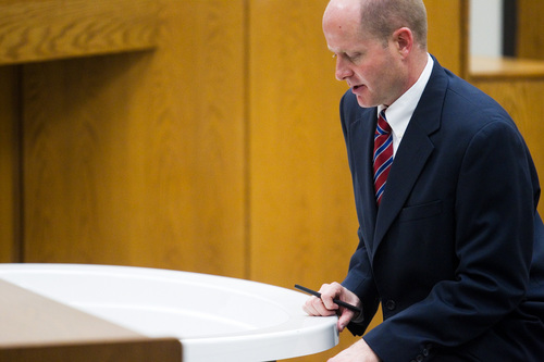 Spenser Heaps  |  Pool  Utah County Prosecutor Chad Grunander motions to a bathtub while questioning Dr. Leo Sam Van Wagoner, not pictured, during the trial of Martin MacNeill at 4th District Court in Provo on Wednesday, Oct. 23, 2013. MacNeill, a Pleasant Grove physician, is charged with murder for allegedly killing his wife Michele MacNeill in 2007.