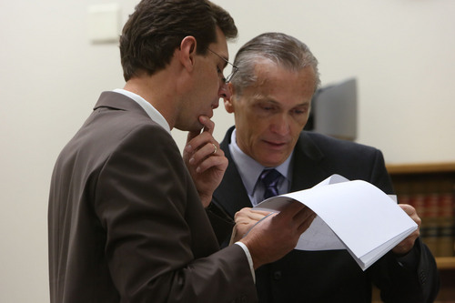 Francisco Kjolseth  |  The Salt Lake Tribune Defense attorney Randy Spencer speaks with his client Martin MacNeill, charged with murder for allegedly killing his wife, Michele MacNeill in 2007, in Judge Derek Pullan's 4th District Court in Provo on Friday, Oct. 25, 2013.
