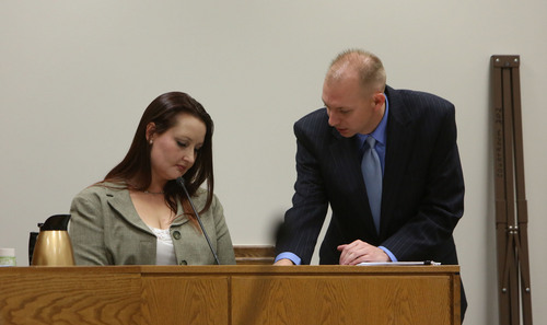 Francisco Kjolseth  |  The Salt Lake Tribune Gypsy Willis who was in an extramarital affair with Pleasant Grove physician Martin MacNeill, is presented with phone records by Utah County Prosecutor Sam Pead, showing her communications with the defendant who is charged with murder for allegedly killing his wife, Michele MacNeill in 2007, during court in Judge Derek Pullan's 4th District Court in Provo on Friday, Oct. 25, 2013.