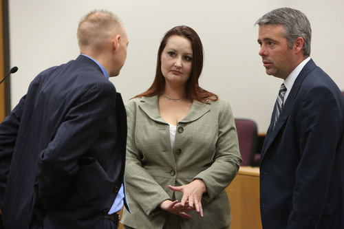 Francisco Kjolseth  |  The Salt Lake Tribune Utah County Prosecutor Sam Pead, left, speaks with Gypsy Willis,  who was in an extramarital affair with Pleasant Grove physician Martin MacNeill, charged with murder for allegedly killing his wife, Michele MacNeill in 2007. At right is Willis' attorney John Easton as they appear in court in Judge Derek Pullan's 4th District Court in Provo on Friday, Oct. 25, 2013.