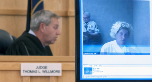Heidi Rutchey appears on a video screen for an arraignment as Judge Thomas Willmore listens, Friday, Oct. 25, 2013, in Logan, Utah. Rutchey is being charged with first degree murder in the death of her 2-year-old son. (Eli Lucero/Herald Journal)