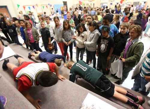 Francisco Kjolseth  |  The Salt Lake Tribune A few brave students took on a push-up challenge as Amelia Earhart Elementary School in Provo celebrated the beginning of National School Lunch Week with a Utah Nutrition Fair earlier this month. Each station at the fair explained the importance of living a healthy lifestyle, how food can be fun and facts about the variety of fresh produce grown in Utah.