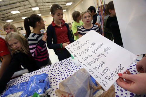 Francisco Kjolseth  |  The Salt Lake Tribune Amelia Earhart Elementary School students in Provo tried to figure out smells in unmarked containers as they celebrated the beginning of National School Lunch Week with a Utah Nutrition Fair earlier this month.