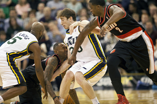 Lennie Mahler     The Salt Lake Tribune Portland guard Mo Williams collides with Utah's Gordon Hayward as they struggle to corral a loose ball as the Utah Jazz faced the Portland Trailblazers at EnergySolutions Arena on Wednesday, Oct. 16, 2013. Portland beat Utah 99-92.