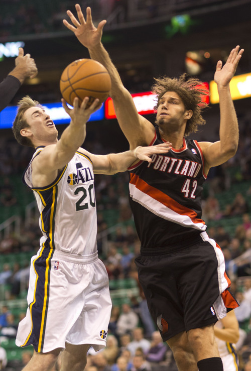 Lennie Mahler     The Salt Lake Tribune Gordon Hayward drives to the basket against Portland's Robin Lopez as the Jazz face the Blazers at EnergySolutions Arena on Wednesday, Oct. 16, 2013.