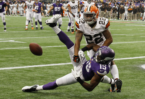Cleveland Browns cornerback Buster Skrine (22) breaks up a pass in the end zone intended for Minnesota Vikings wide receiver Greg Jennings (15) during the first half of an NFL football game Sunday, Sept. 22, 2013, in Minneapolis. (AP Photo/Ann Heisenfelt)