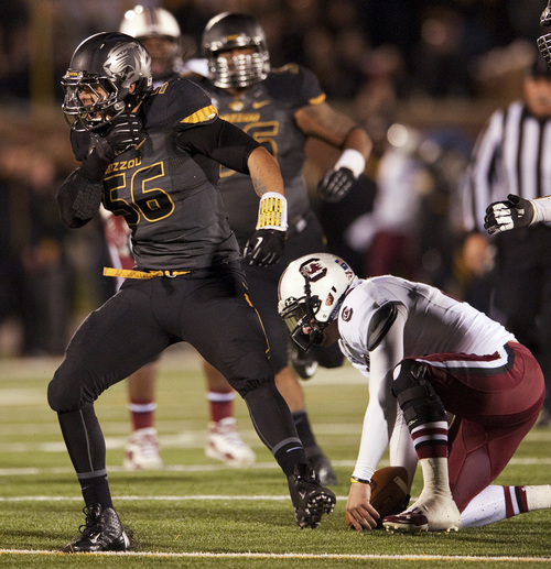 Missouri's Shane Ray, left, celebrates after sacking South Carolina quarterback Connor Shaw, right, during the third quarter of an NCAA college football game Saturday, Oct. 26, 2013, in Columbia, Mo. (AP Photo/L.G. Patterson)