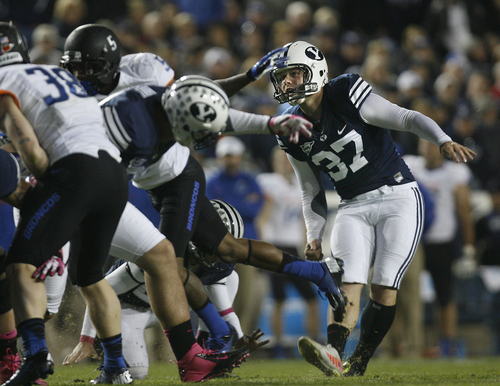 Scott Sommerdorf   |  The Salt Lake Tribune Brigham Young Cougars kicker Justin Sorensen (37) kicks one of his three field goals to seal the win over Boise State. BYU defeated Boise State 37-20, Friday, October 25, 2013.